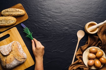 Hand placing flower next to bread