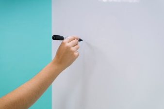 Hand ready to write on the whiteboard