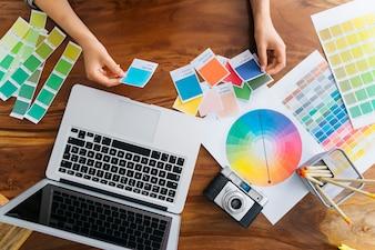 Hands of graphic designer working at desk