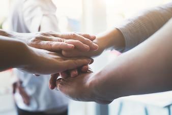 Hands of success startup business teamwork.