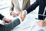 Handshake close-up of executives