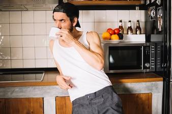 Handsome adult man on kitchen