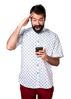 Handsome brunette man with beard talking to mobile