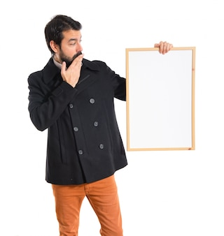 Handsome man holding empty placard