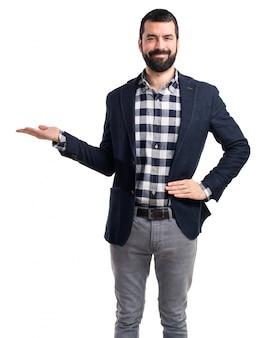 Handsome man holding something