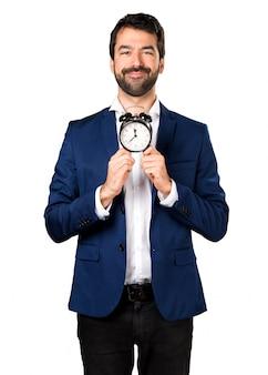Handsome man holding vintage clock