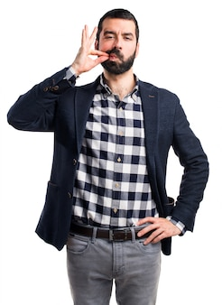 Handsome man making silence gesture