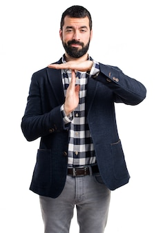 Handsome man making time out gesture