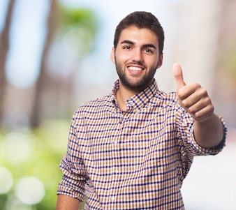 Handsome man showing thumbs-up
