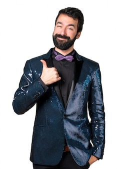 Handsome man with sequin jacket with thumb up