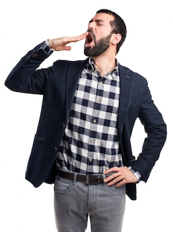 Handsome man yawning