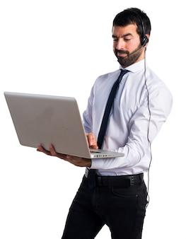 Handsome telemarketer man with laptop