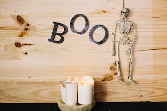 Hanged Halloween skeleton with boo letters