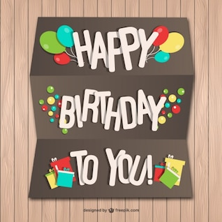 Happy Birthday paper card on wood wall