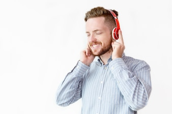 Happy businessman listening to music at break