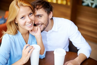 Happy couple having fun in coffee shop