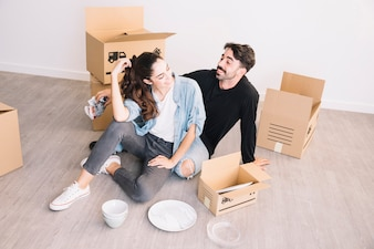 Happy couple sitting in new flat