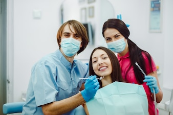 Happy dentists with the patient