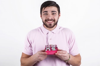 Happy emotional man with gifts on special day
