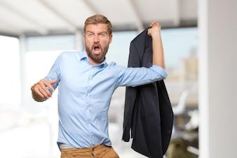 Happy entrepreneur holding his jacket