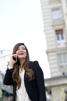 Happy executive closing a deal by phone