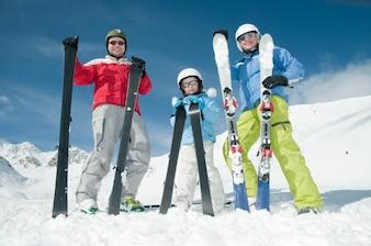 Happy family in the snow
