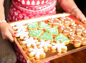 Happy family with a cookies tray on christmas