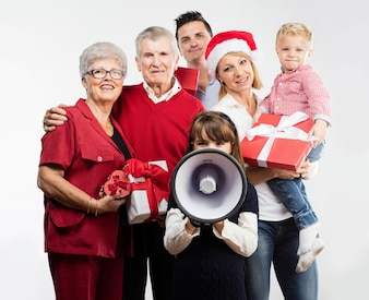 Happy family with gifts and megaphone