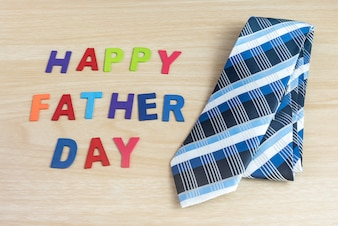 Happy fathers day words and colorful tie laid