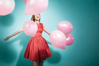 Happy girl playing with balloons