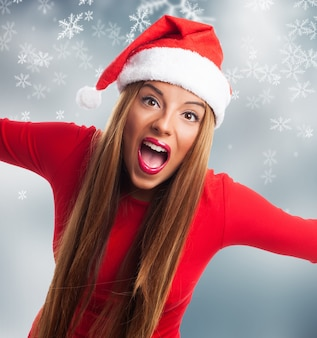 Happy girl with santa hat and open mouth