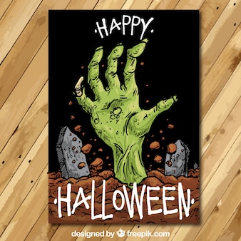 Happy halloween card with a hand drawn zombie hand