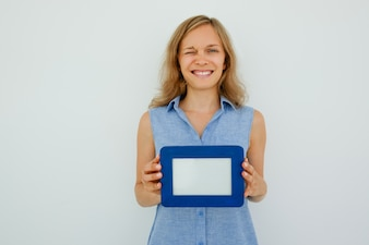 Happy Lady Winking and Holding Empty Picture Frame