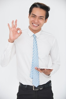 Happy manager with touchpad showing ok gesture