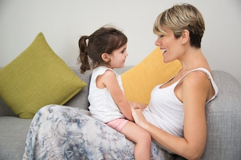 Happy mother enjoying communication with daughter
