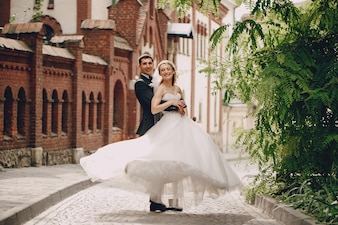 Happy newlyweds posing in the town
