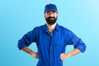 Happy plumber on colorful background