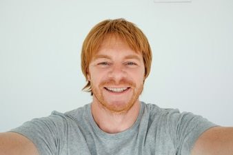 Happy Red-haired Man Taking Selfie Photo