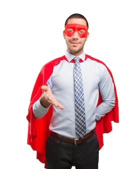 Happy super businessman welcoming