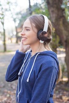 Happy teenager enjoying music before running