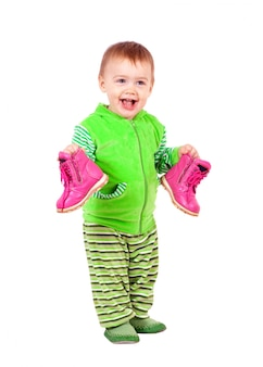 Happy toddler holds shoes