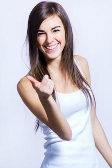 Happy woman pointing at camera