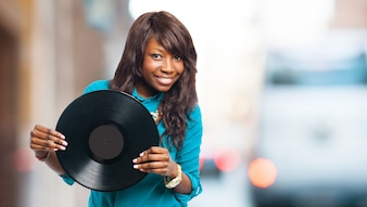 Happy woman with a vinyl record