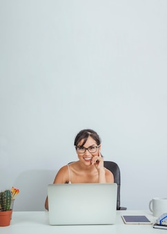 Happy woman working in the office