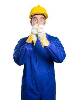 Happy workman with teamwork gesture on white background