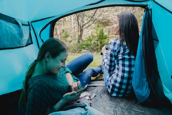 Happy young girls in the tent