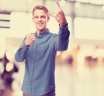 Happy young man rock gesture