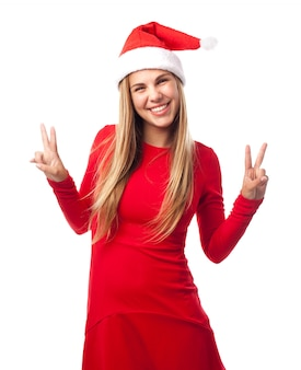 Happy young woman showing victory gestures