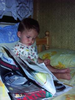 He is reading a magazine
