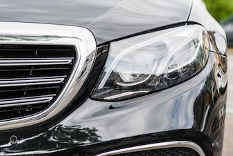 Headlights of black modern car